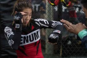 ONE Championship atomweight champion Angela Lee training at the Evolve MMA gym.