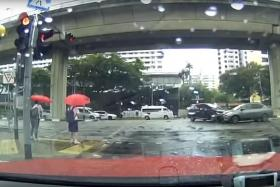 Near miss for two pedestrians as cars collide in Bedok