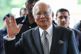 Najib wants cops to return $39m, claims the money is Umno funds