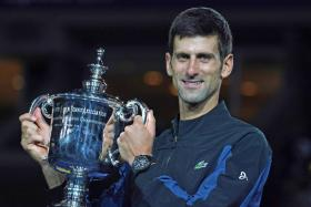 The victory over del Potro puts Djokovic (above) three Slam wins away from Nadal's 17 and six behind Federer's record 20.