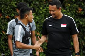 Fandi Ahmad (right, with Zulfadhmi Suzliman) says tonight's result is important, but he also wants to build the team.
