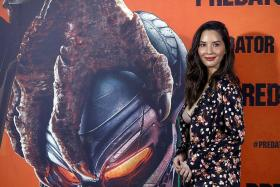 Olivia Munn toughens up, fights for her life in The Predator