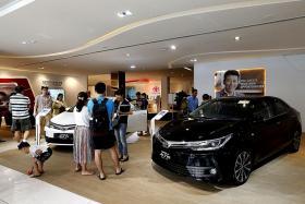 Retail sales fall in July, hit by motor vehicles sales slowdown