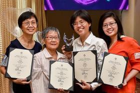 Volunteers receive award for mentoring 11-year-old girl