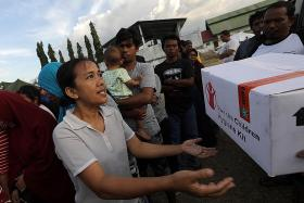 5,000 people believed missing in two hard-hit quake zones