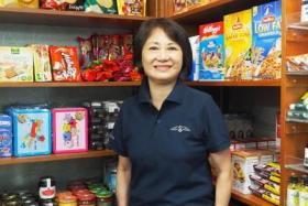 Madam Betty Koh has been a retail assistant at the convenience store at The American Club for seven years.