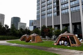 Out of Japan's offices and into tents