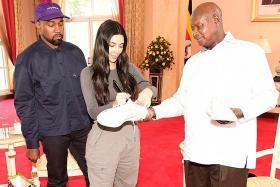 Kanye West gifts white sneakers to Uganda president