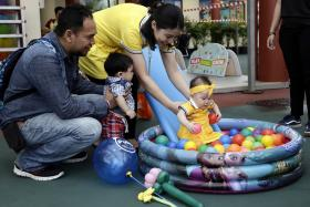 Parents enjoying fun activities with their children at the Embracing PArenthood Celebration at Teck Ghee community center. PHOTO: THE STRAITS TIMES