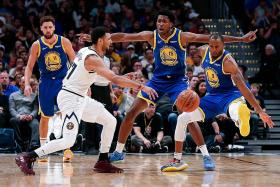 Nuggets stun champs Warriors to go to 3-0