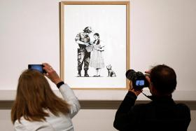 Banksy prints sell intact at stunt-free Paris auction