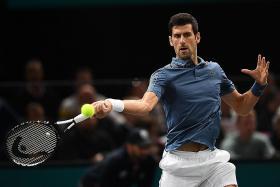 Djokovic reaches new landmark