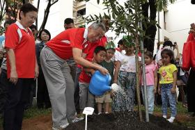 PM Lee plants trees with residents at annual event