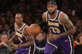 Lakers and James keep the Wolves at bay