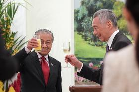PM Lee, Dr Mahathir reaffirm strong relations