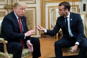 Trump lashes out at Macron over defence proposal
