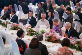 Prime Minister Lee Hsien Loong (above, seated with his wife, Ms Ho Ching, and Chinese Premier Li Keqiang) at last night's gala dinner that featured dishes inspired by local culinary influences.