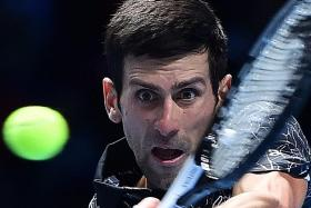 Sick Djokovic grinds out win over Zverev