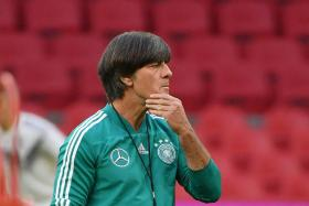 Joachim Loew (above) will be hoping that the youngsters he blooded in during their 3-0 win over Russia can help Germany recover from their slump.