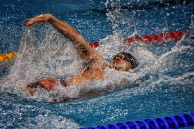 Joseph Schooling swimming the backstroke leg of the 4x50m medley relay during the Singapore leg of the Fina Swimming World Cup on Saturday.