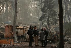 Trump visits fire-wracked California, blames mismanagement