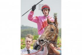 Jockey John Powell saluting aboard I'm Incredible in Race 4 at Kranji yesterday.
