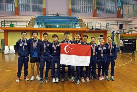 Young Singapore male paddlers show their potential with four golds