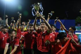 The Promotional Fund for Vietnamese Football Talents (PVF) U-15 team celebrating their victory in the FAS U-15 International Challenge Cup on Saturday (Dec 1).