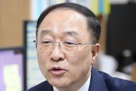 S Korea's incoming finance minister says economy losing momentum