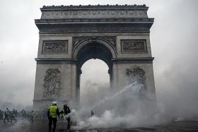 Tear gas fired at protestors in Paris riots leaves S'porean in tears