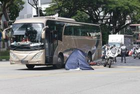 Cyclist dies after getting knocked down by bus