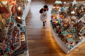 Architects build gingerbread city in London's V&A Museum