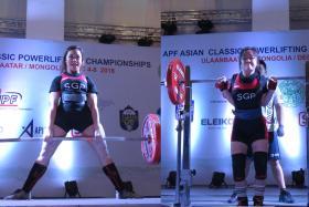 Singapore's female powerlifters Farhanna Farid (left) and Thor Qian Qi.