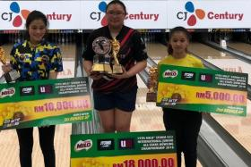 Singapore's Charmaine Chang (centre) winning the 19th Milo Storm U22 International Junior All Stars Bowling Championship in Petaling Jaya.