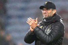 Karl-Heinz Riedle believes his compatriot Juergen Klopp (above) is well-equipped to handle the pressure of the title race.