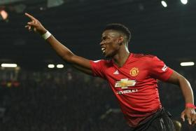 Paul Pogba made sure Manchester United interim manager Ole Gunnar Solskjaer won on his Old Trafford return with a double in a 3-1 win over Huddersfield.