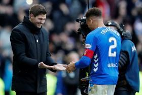 Rangers manager Steven Gerrard celebrates after the match with James Tavernier.