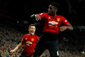 Paul Pogba celebrates scoring their second goal with Ander Herrera.