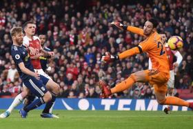 Granit Xhaka scoring the first goal for Arsenal.
