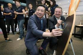 ITTF CEO Steve Dainton (right) and Chinese businessman Frank Ji at the opening of the ITTF's new Apac office in Singapore yesterday.