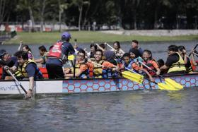 Persons of all abilities trying out dragon-boating at the Let's Play! at PAssion WaVe @ Marina Bay event on Saturday.