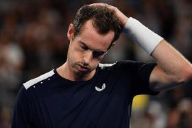 Murray bows out after gutsy five-setter