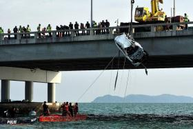 The recovery team used four cables attached to a crane to lift the Mazda CX-5 SUV, submerged at a depth of 15m, out of the water. The body of 20-year-old college student Moey Yun Peng was found in the driver's seat. The car had plunged into the sea after colliding with another vehicle at the 4km point of Penang Bridge in the early hours on Sunday.