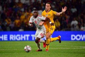 United Arab Emirates' midfielder Ismail Al Hamadi (left) fending off the challenge of Australia's midfielder Jackson Irvine.