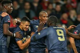 Manchester United forward Alexis Sanchez (second from left) celebrates with his teammates after scoring against his former club Arsenal.