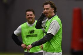 Former Liverpool players Steve McManaman with Michael Owen (background) in preparation for the Liverpool legends' match against the AC Milan legends at Anfield in March.