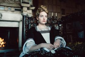 (Above) Emma Stone in The Favourite and with British actress Olivia Colman.