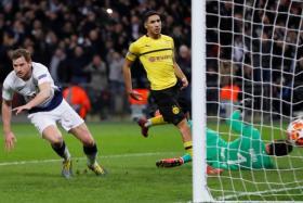 Jan Vertonghen celebrates after scoring Tottenham Hotspur's second goal in their 3-0 win over Borussia Dortmund.