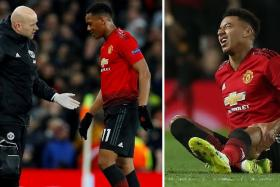 Anthony Martial (centre) and Jesse Lingard (right) suffered injuries during their Champions League match against Paris Saint-Germain.