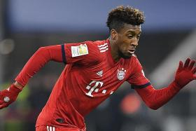 Bayern fly to Liverpool without Boateng, waiting on Coman